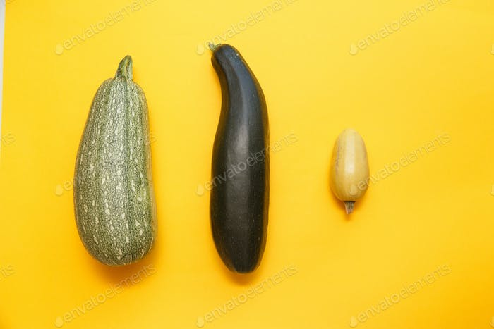 Fresh vegetables on yelow isolated background. Flat lay