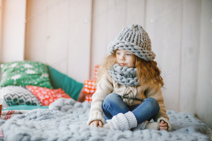 baby girl in knitted hat and scarf