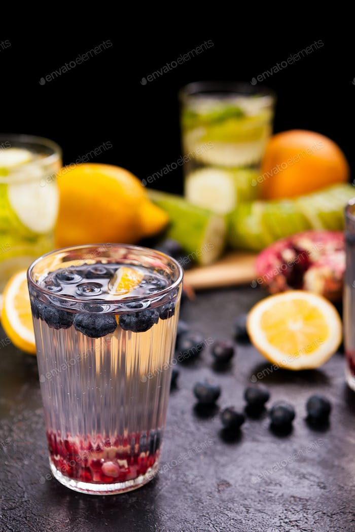 Healthy homemade lemonade from different organic fruits