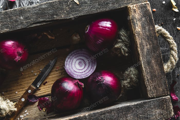 detail of onion inside the box with dark background. Wholesome healthy food