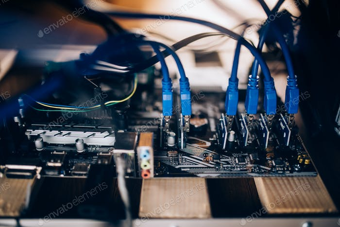 Details of modern mining rig. Graphics cards with power supply mining cryptocurrency like bitcoin