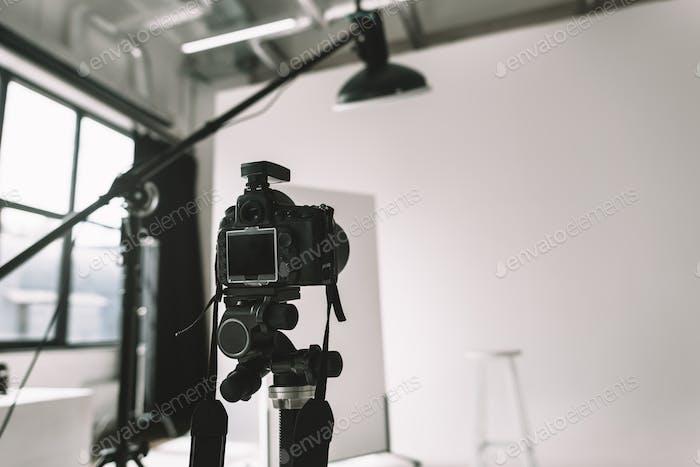 digital photo camera in photo studio with lighting equipment