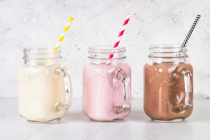 Banana, chocolate and strawberry milkshakes