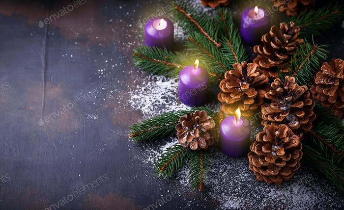 Pine cones and candle