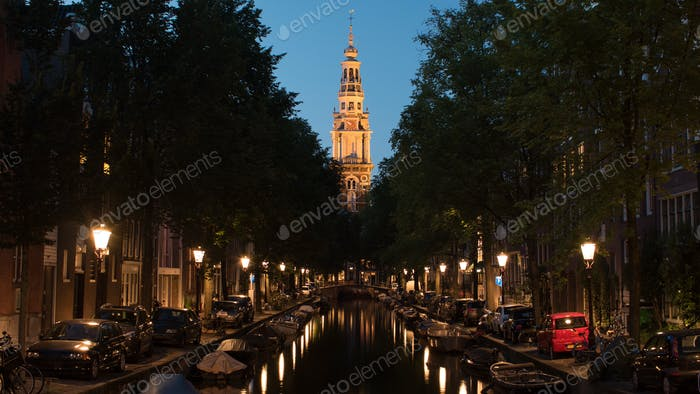 Night view of Amsterdam with canal and Zuiderkerk, Netherlands