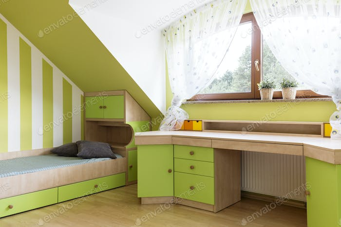 Bright lime room for teenager at the attic