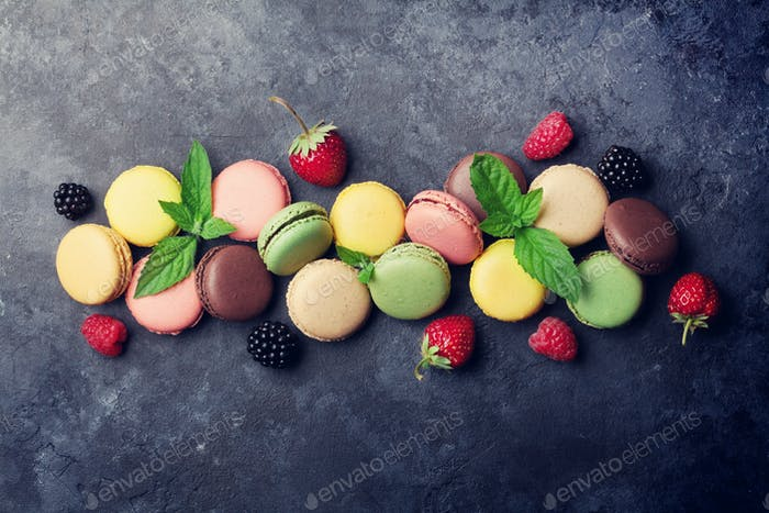 Colorful macaroons and berries