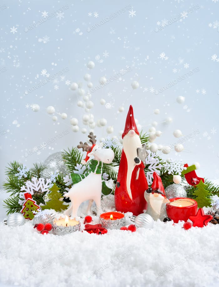 Christmas decorations cute figure elk and gnomes with festive decorations оn the snow