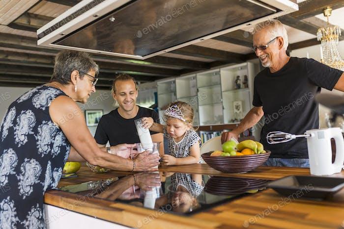 Grandparents preparing food with granddaughter (2-3)
