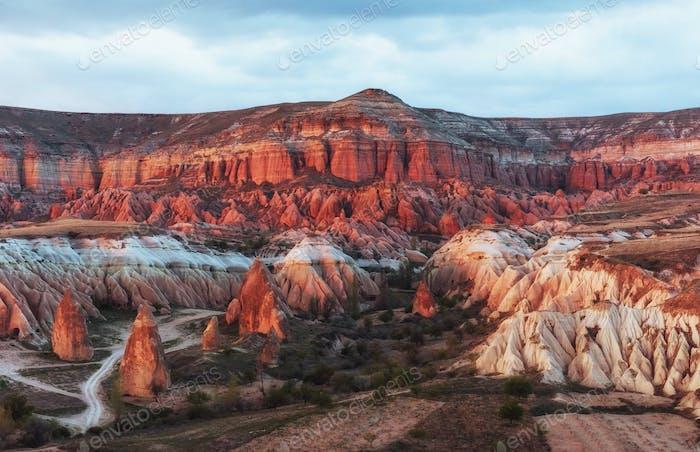 Red valley at Cappadocia, Anatolia, Turkey. Volcanic mountains i