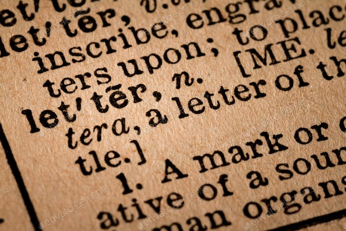 Close-up of an Opened Dictionary showing the Word LETTER