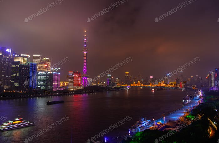 Large famous Shanghai tower reflected in Huangpu