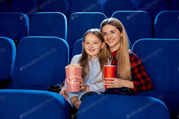 Mother spending time with daughter in cinema