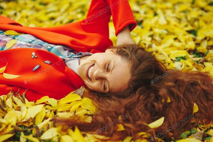 Thumbnail for Young beautiful lady surrounded autumn leaves
