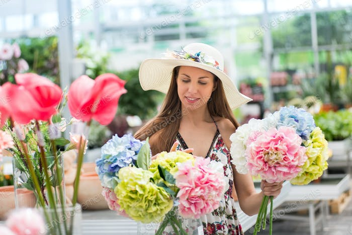 Young woman choosing a bunch of fresh hydrangeas