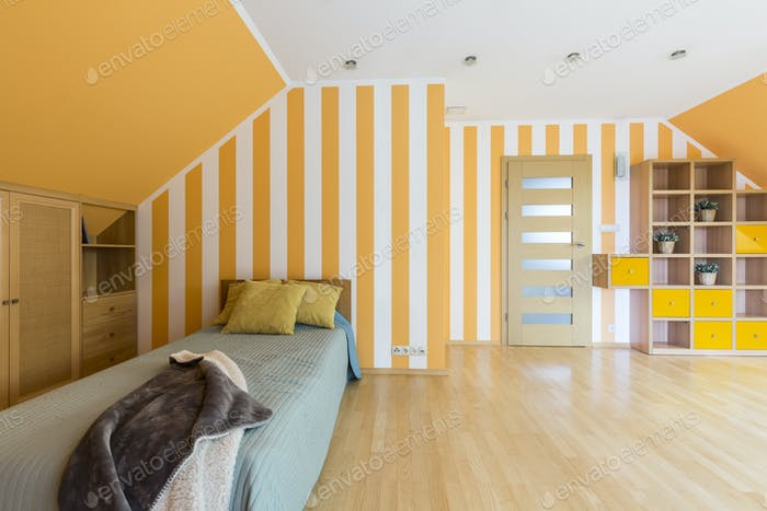 Bedroom with striped yellow wall