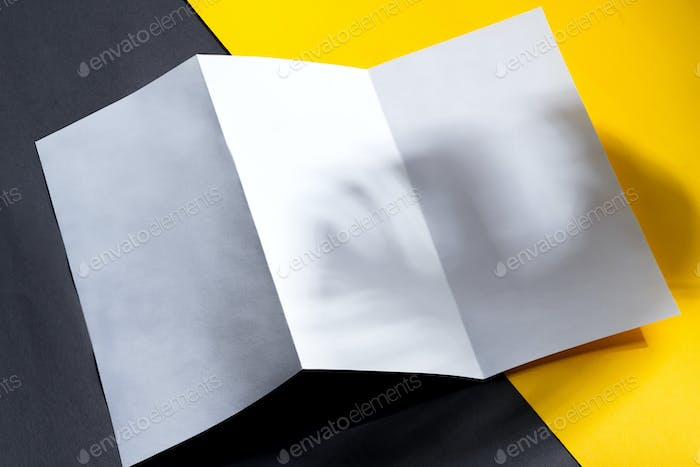 Minimal trifold brochure template above duotone background with shadows
