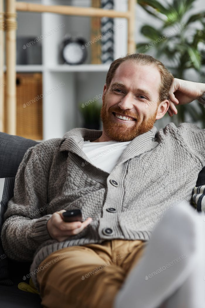 Smiling Adult Man Watching TV