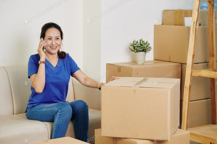 Woman calling to moving service company