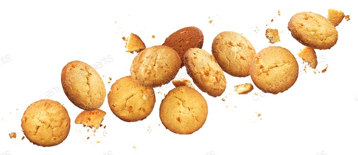 Falling broken chip cookies isolated on white background with clipping path