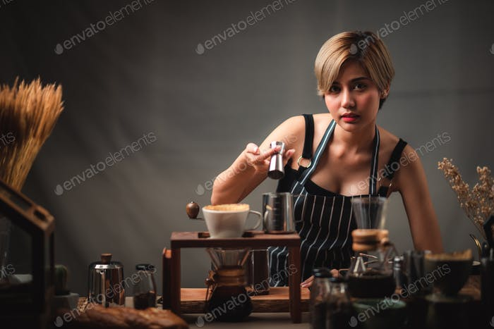Portrait of a young woman Asian barista, coffee cafe worker concept