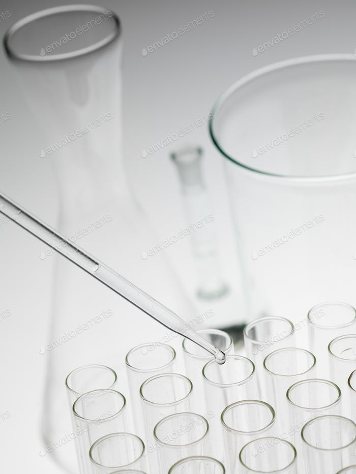 laboratory experiments glassware on white background