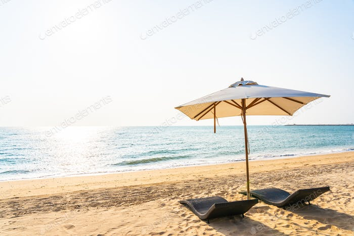 Chair umbrella and lounge on the beautiful beach sea ocean on sk