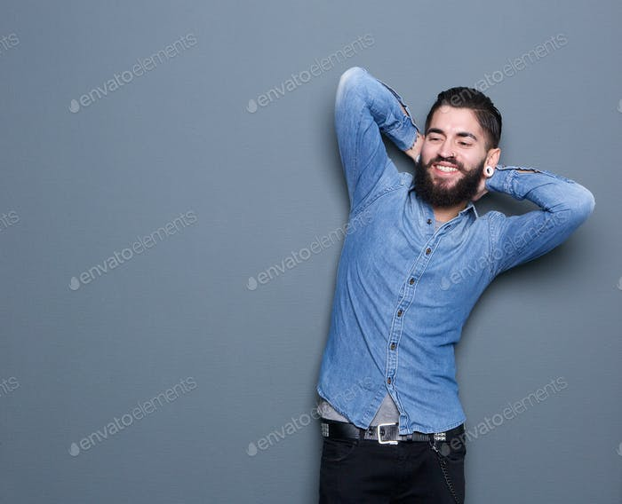 trendy young man with beard relaxing