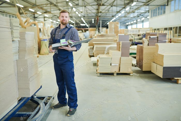 Confident inventory auditor working at warehouse