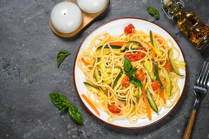 Pasta spaghetti with zucchini, carrot and tomato
