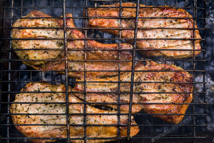 Spare ribs cooking on barbecue grill for summer outdoor party