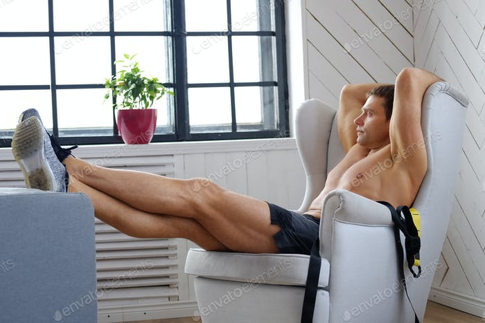 A man relaxing on a chair.
