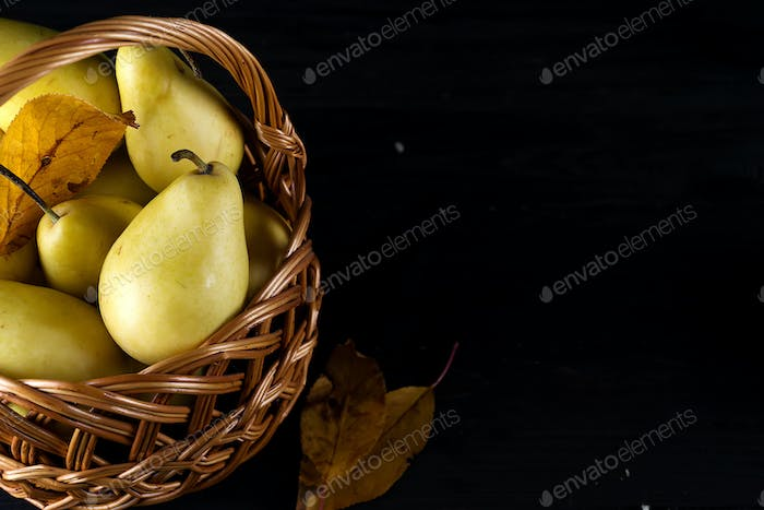 Pear basket pear orchard fresh ripe pears on dark wooden background
