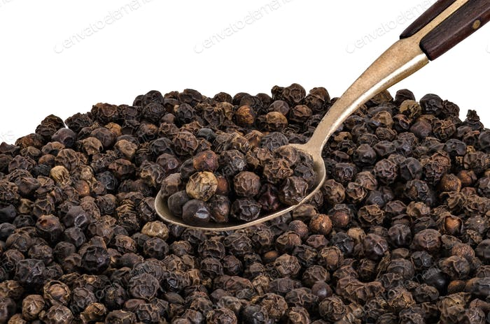 Whole Black Pepper on  Old  Brass Spoon