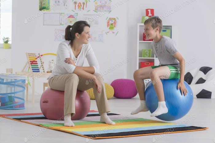 Boy sitting on gym ball