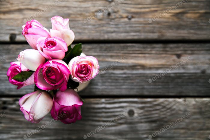 Pink roses on a wooden table. Vintage. flowers