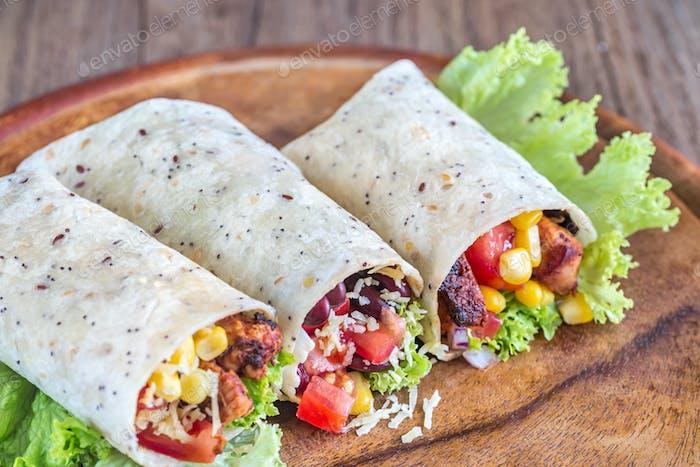 Three chicken burritos