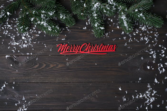 Christmas wooden background with snow fir tree.