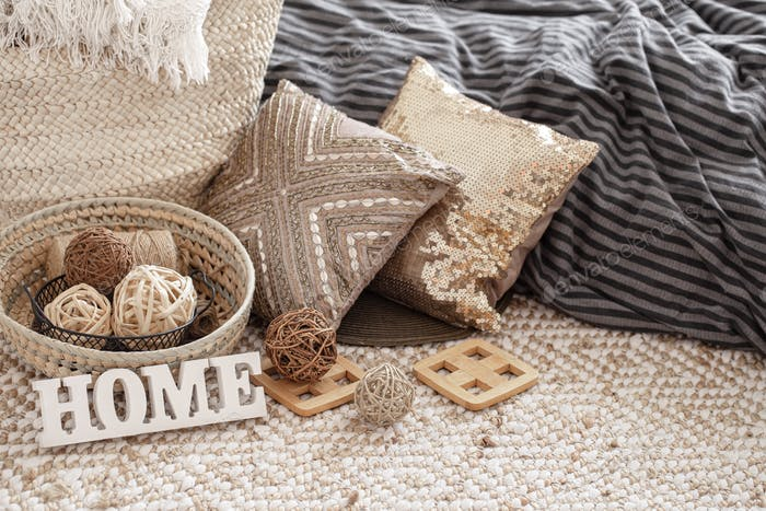 Items of a cozy home interior with pillows.