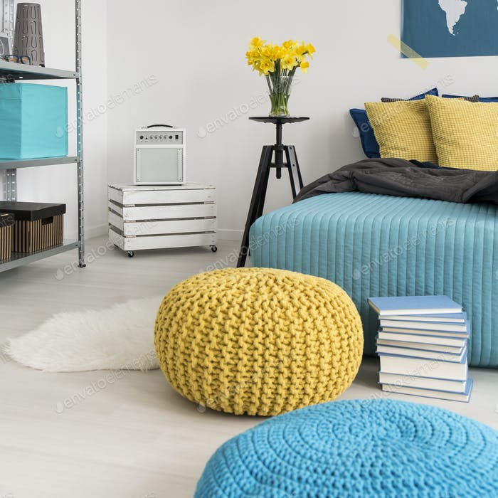 Poufs and bed in bedroom