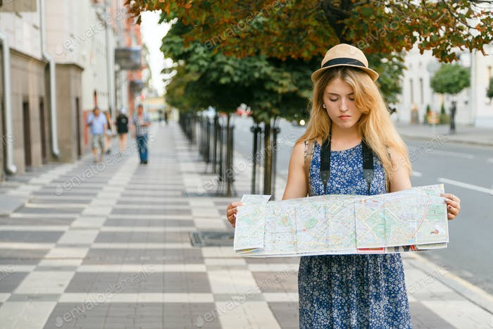 woman traveler lost in foreign city