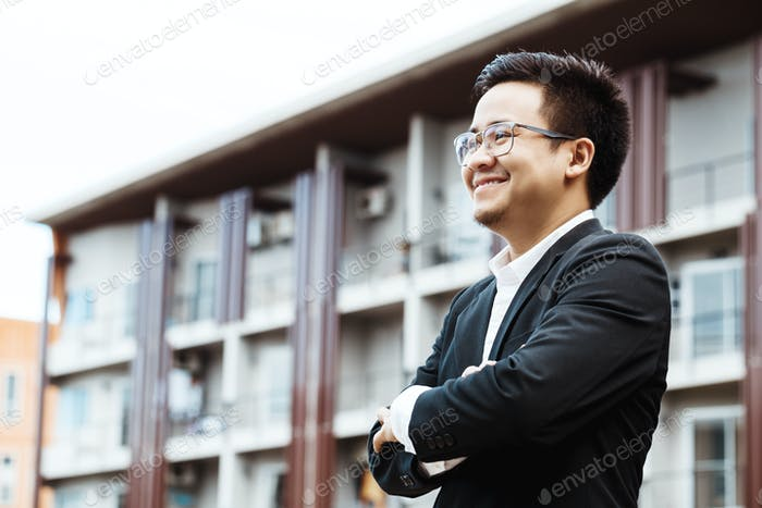 Portrait of a smiling handsome businessman with arms folded