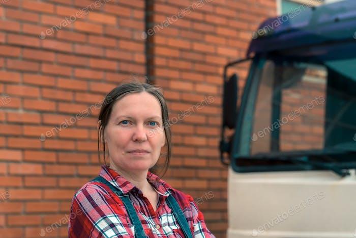 Female farmer and medium duty farm truck