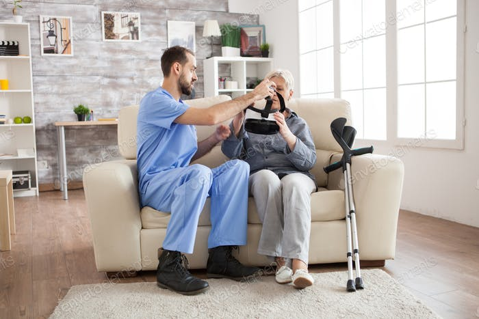 Caucasian doctor in nursing home with senior woman