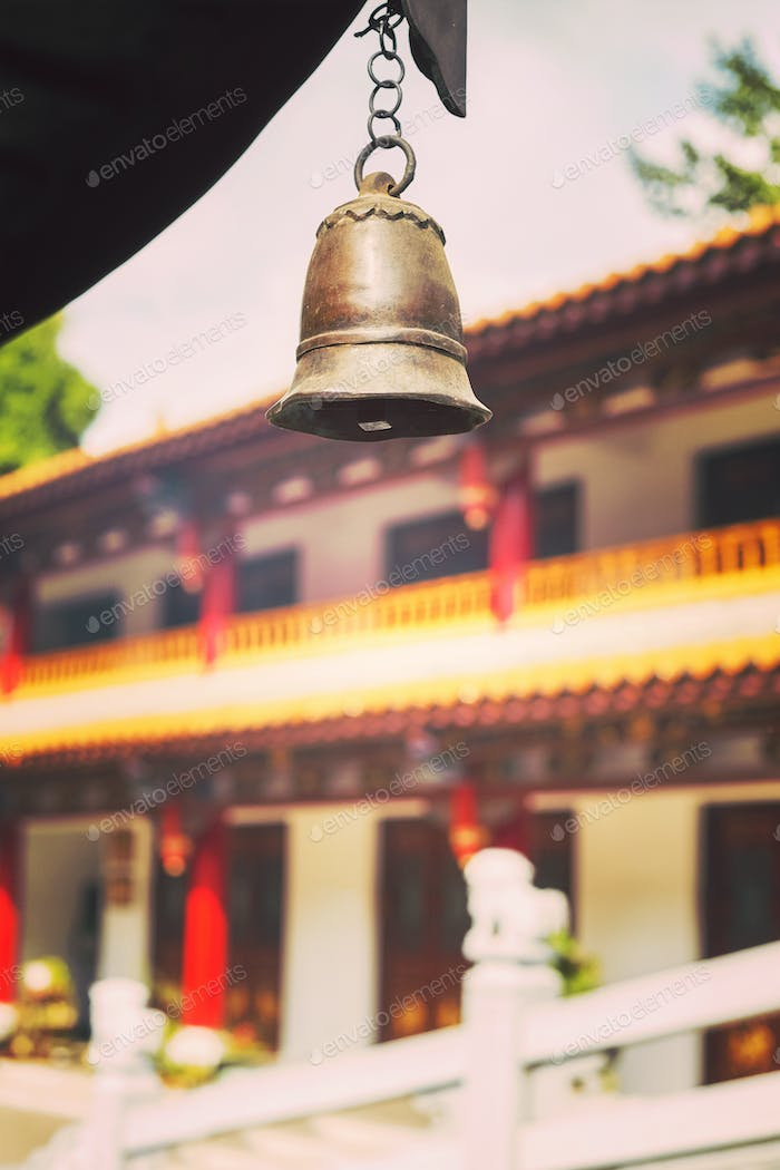 Color toned picture of a temple bell, China.