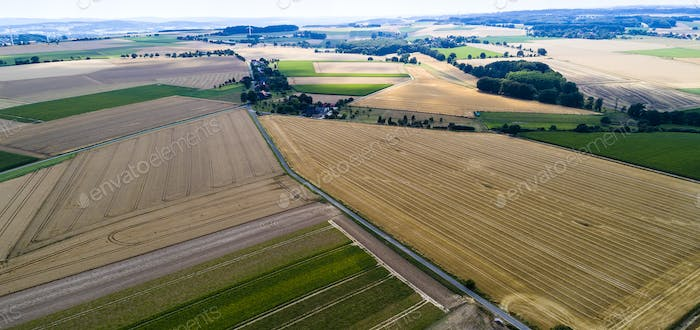 Aerial view of a country side with agricultural fields