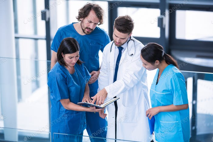 Surgeons, doctor and nurse having a discussion