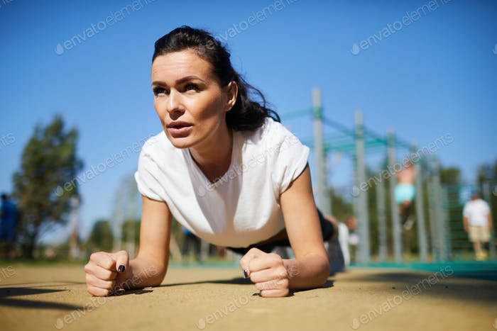 Athletic woman concentrated on exercise