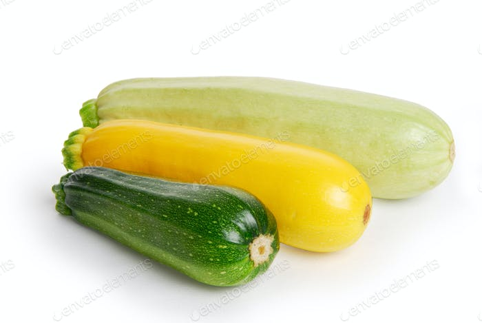 Three fresh marrow squash on white