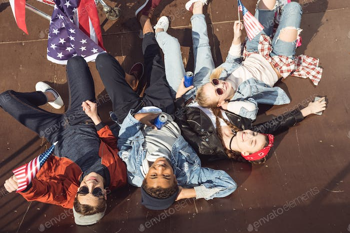 Teenagers Lying With American Flag